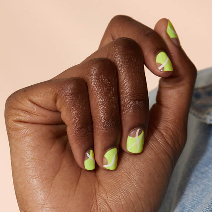 Close-up image of a model's clenched hand with slime green nail art