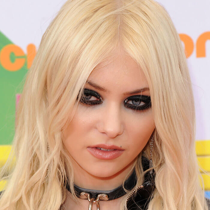 Taylor Momsen rocking a goth makeup look and leather choker
