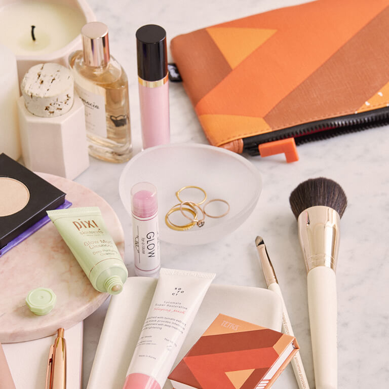 A table full of makeup, tools, and skincare products