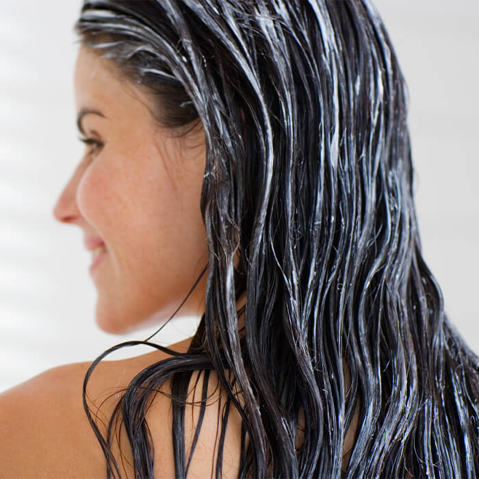 Image of a woman with coconut oil on her hair