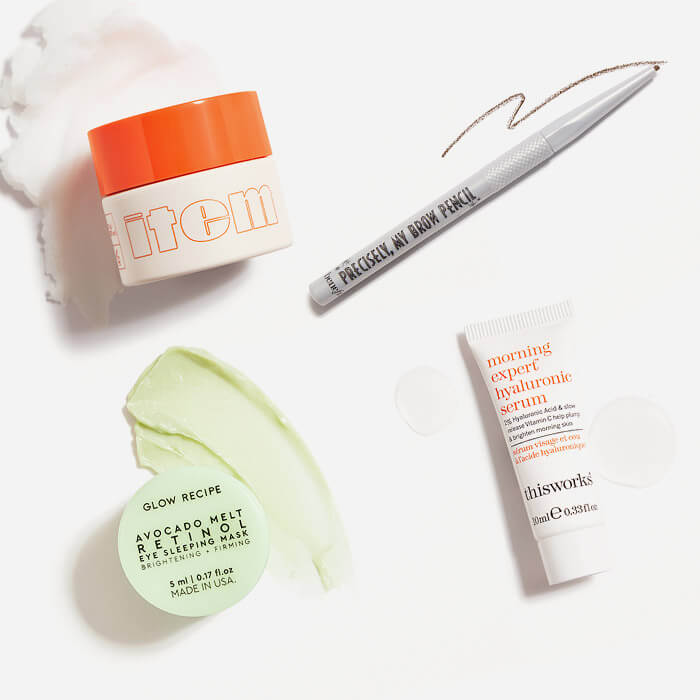 Makeup, hair care, and skincare products from the August 2021 IPSY Glam Bag swatched on white background