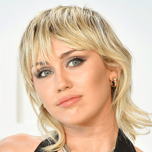 Close-up of Miley Cyrus rocking a mullet hairstyle with bangs