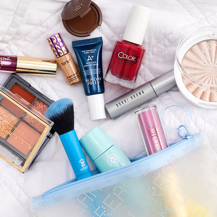 January 2021 IPSY Glam Bag, makeup, skincare, and nail products and makeup brush on white quilted cloth