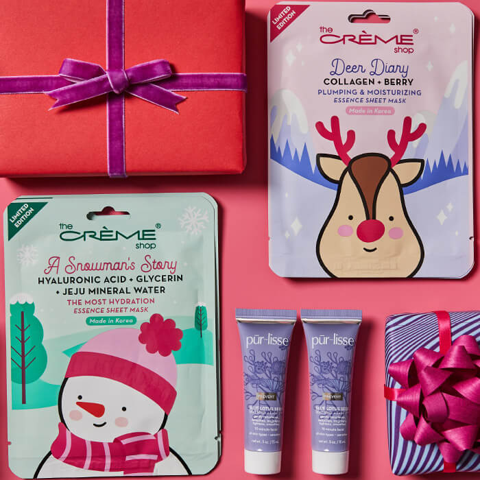 Flat lay image of different face masks from various brands and colorful gift boxes on pink background