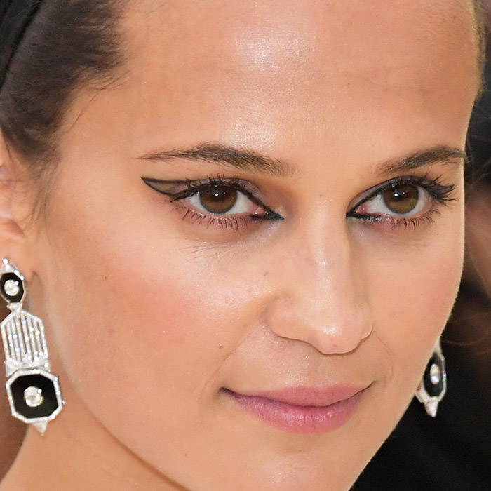 A photo of Alicia Vikander with a graphic eyeliner outline