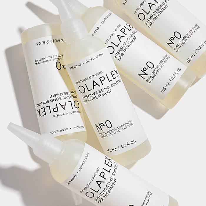 A photo of OLAPLEX No.0 Intensive Bond Building Treatment bottles on a white background