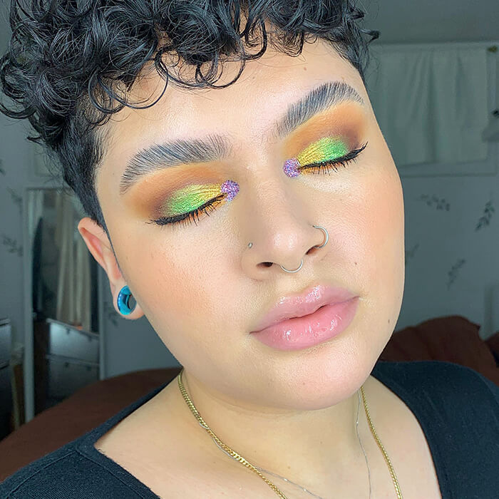 Close-up of Karol Rodriguez showing off her colorful eyeshadow makeup look