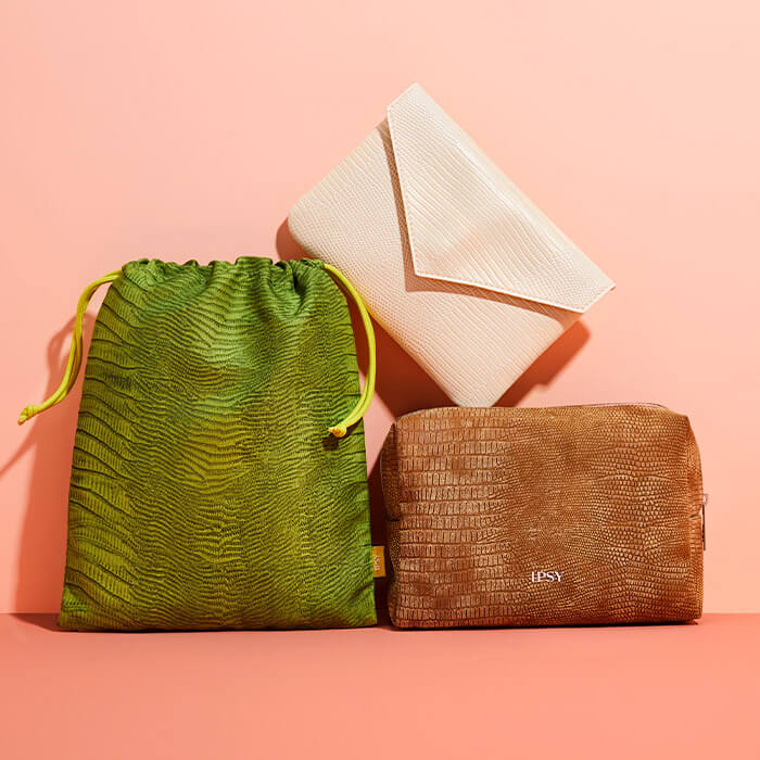 August 2021 IPSY Glam Bag, Glam Bag Plus, and Glam Bag X bags on coral peach background