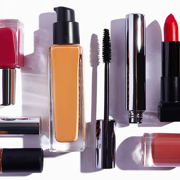 Various beauty products neatly arranged on white background
