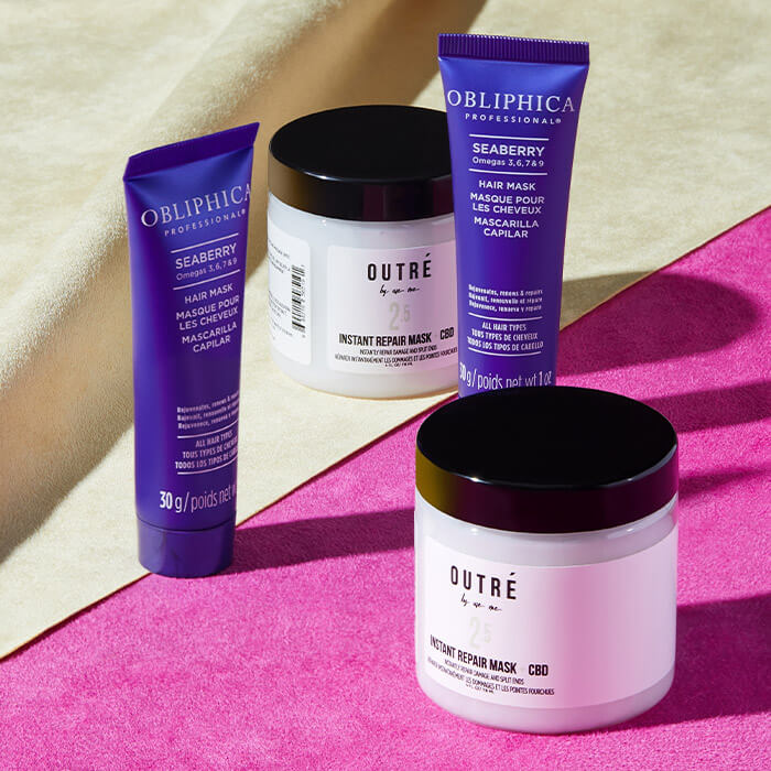 Two jars of OUTRE BY USE ME Instant Repair Hair Mask + CBD and two jars of OBLIPHICA PROFESSIONAL Seaberry Hair Mask on top of hot pink and cream textile