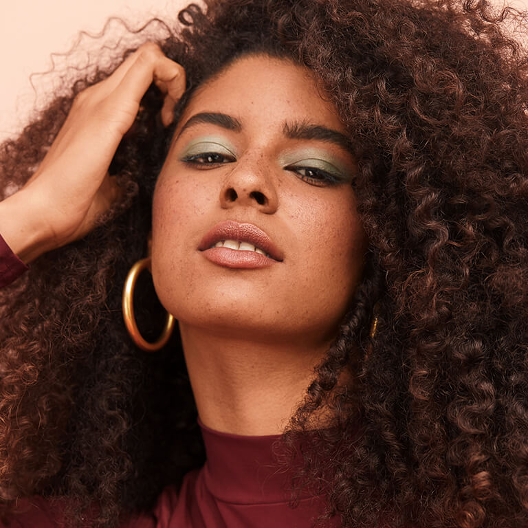 How To Style Curly Hair 15 Tips Products Tricks For Frizz Free Defined Curls Ipsy