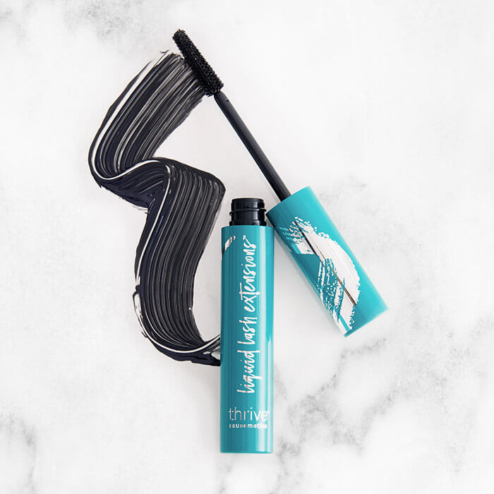 THRIVE CAUSEMETICS Liquid Lash Extensions Mascara™ in Brynn swatched on black and white marble background