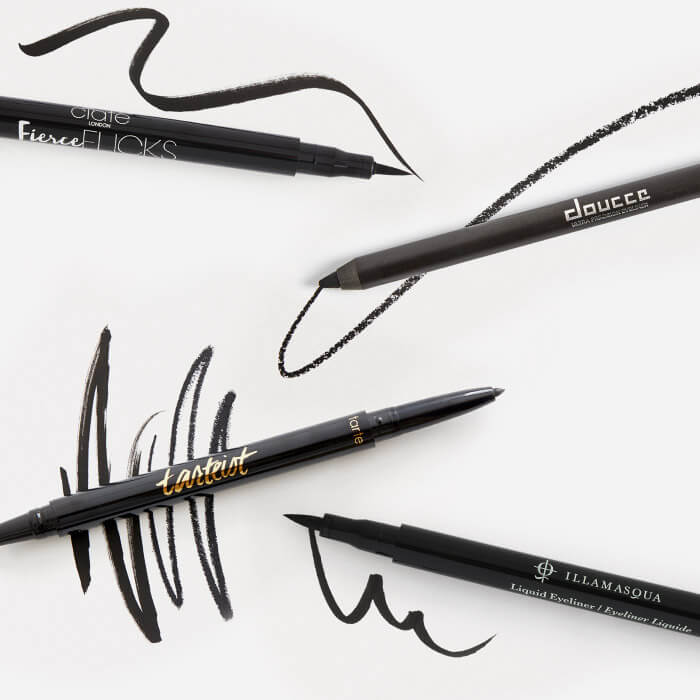 Four smudge proof eyeliners from various brands swatched on white background