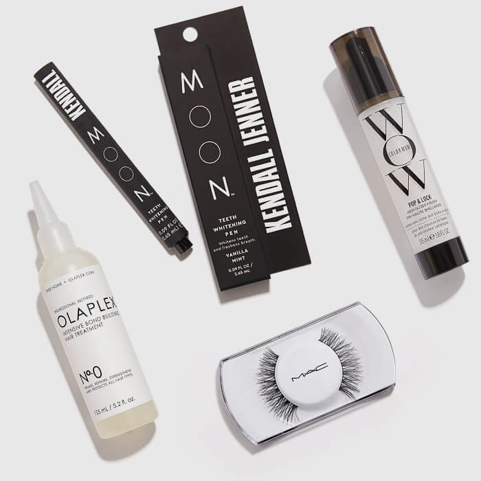 Skincare, hair care, and makeup products from the May 2021 Glam Bag X arranged on white background