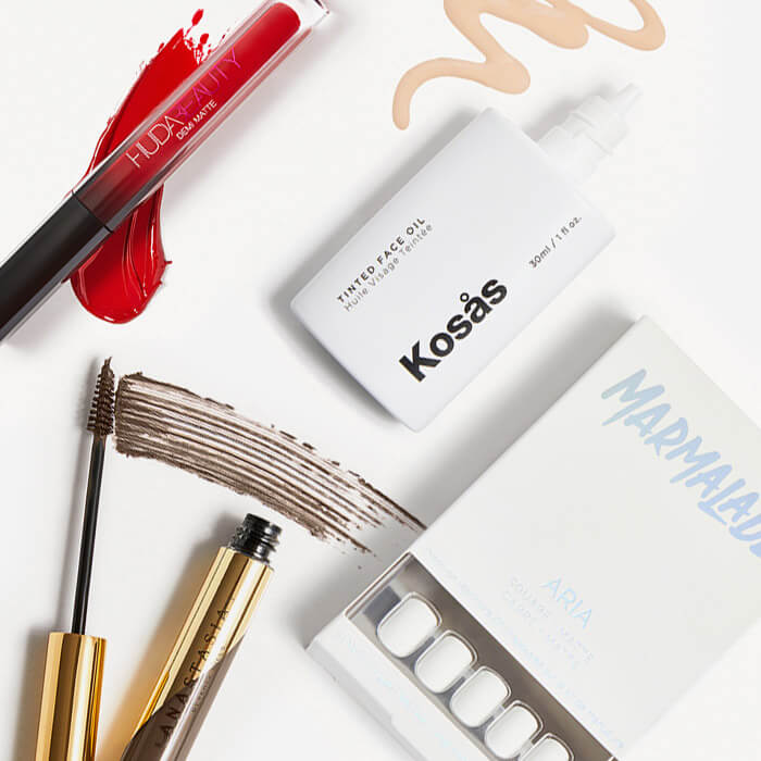 Makeup and nail products from the March 2021 IPSY Glam Bag Plus swatched on white background