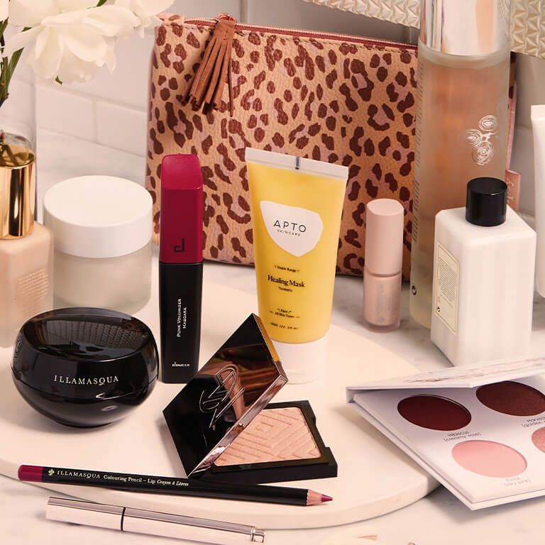 An image of makeup tools, makeup, and skincare products on a flat surface