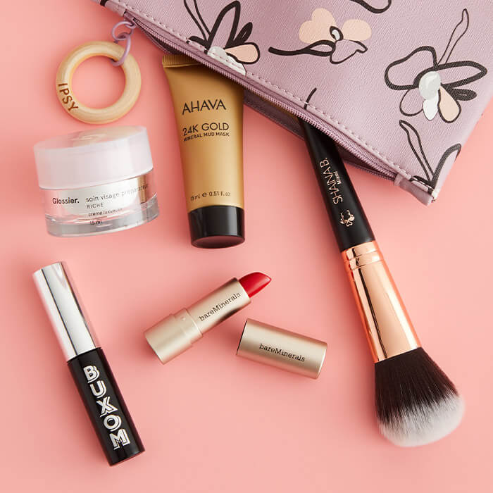 An image of a Glam Bag with products spilling out.