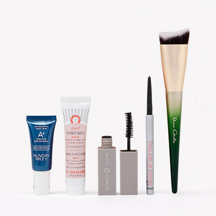 December 2020 IPSY Glam Bag skincare and makeup products and tools standing on white background