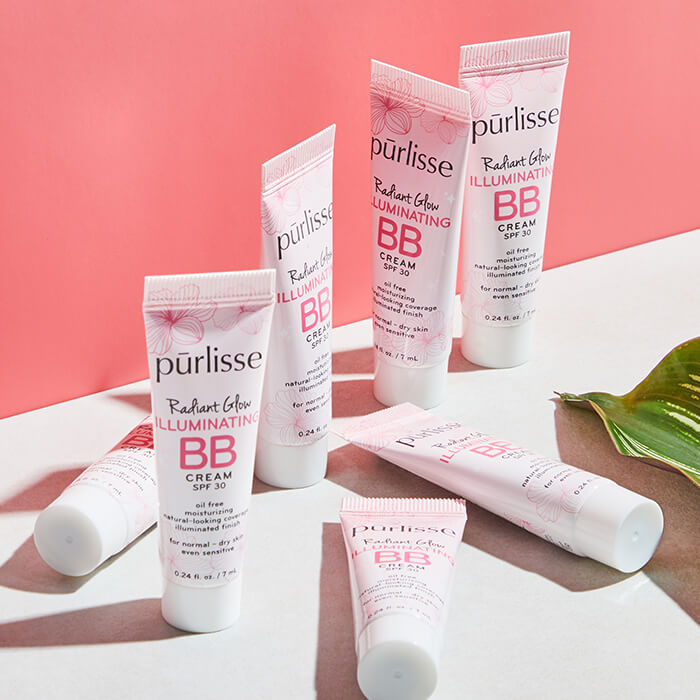 PURLISSE BEAUTY Illuminating BB Cream SPF 30 on a white surface with coral pink background