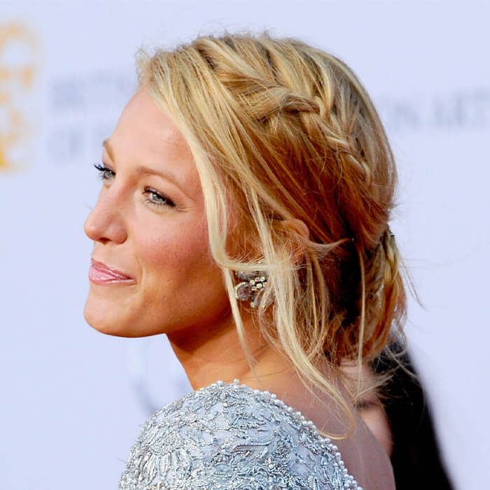 Close-up of Blake Lively rocking a waterfall braided hairstyle and silver sequined dress