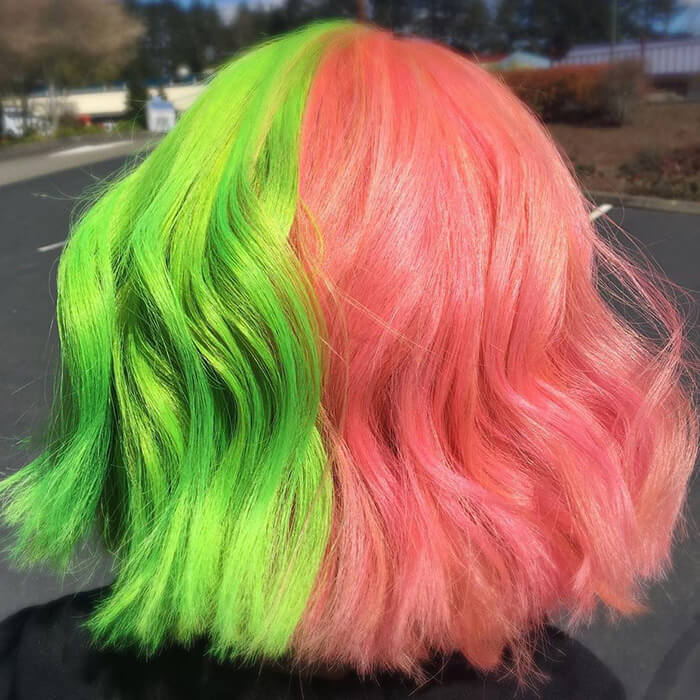 Image of a woman's neon green and pink split hair color